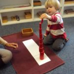 Student playing with knobless cylinders