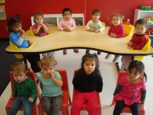 montessori students around a table