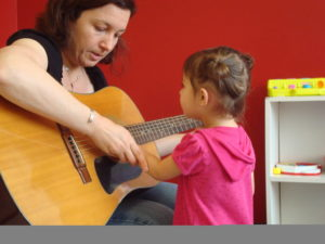 montessori student learns guitar