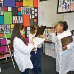 Montessori students learning art