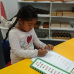 Young girl student learns to write