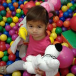 Montessori toddler in the ball pit